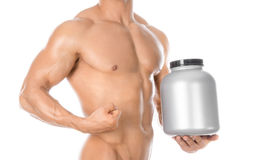 Bodybuilding and Sports theme: handsome strong bodybuilder holding a plastic jar with a dry protein and showing gesture isolated o. N white background Stock Photos