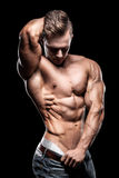 Bodybuilding sportsman showing perfect body muscles Stock Photos