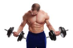 Bodybuilding. Sterke mens met een domoor stock fotografie
