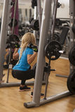 Bodybuilding. Strong fit woman exercising with barbell. girl lifting weights in gym Stock Images