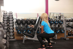 Bodybuilding. Strong fit woman exercising with weight. girl lifting weights in gym Stock Image