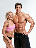 Bodybuilding. Strong man and a woman Royalty Free Stock Images