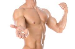 Bodybuilding- und Chemikalienzusätze: hübsche starke farbige Pillen des Bodybuilders Holding lokalisiert auf weißem Hintergrund i Stockfoto