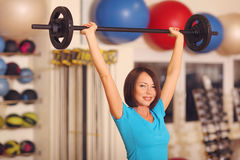 Bodybuilding. woman exercising with barbell in fitness class. Female workout in gym with barbell. Stock Photo