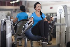 Bodybuilding. woman exercising in gym abs legs up. Royalty Free Stock Photography