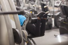 Bodybuilding. woman exercising in gym with exercise-machine Royalty Free Stock Images