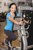 Bodybuilding. woman exercising in gym with exercise-machine Royalty Free Stock Photography
