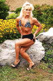 Bodybuilding woman on location. Stock Photos