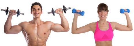 Bodybuildingkvinnamannen tränga sig in byggnad för kroppsbyggarekroppbyggmästaren royaltyfria bilder