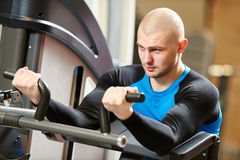 Bodybuiler man at gym have a workout Stock Images
