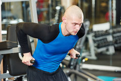Bodybuiler man at gym have a workout Royalty Free Stock Image