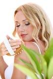 Bodycare. Beautiful blond woman using massage brush Royalty Free Stock Image