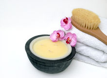 Bodycare Spa Products. Products for a natural healthcare regime at the spa: bath towel, relaxing candle and body brush to cleanse and detox Stock Photo