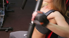 Bodyfitness workout. Athletic trainer for arms and back stock video