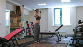 Bodyfitness workout. Exercises with dumbbells stock video