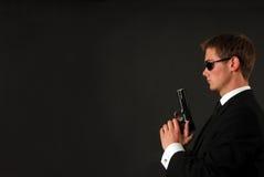 Bodygard avec un pistole Photographie stock libre de droits