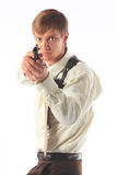 Bodyguard. The young man with a pistol Royalty Free Stock Image