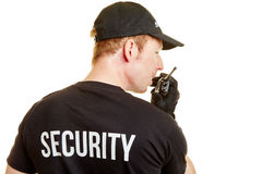Bodyguard alarms his team. With a radio during a mission royalty free stock photos