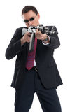 Bodyguard with automatic rifle Stock Images