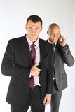 The bodyguard of the businessman. The businessmen and the bodyguard with a pistol Royalty Free Stock Photos