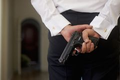 Bodyguard with gun Stock Photography
