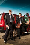 Bodyguard and its boss. Leave the car royalty free stock photo