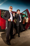 Bodyguard and its boss. Leave the car stock photography