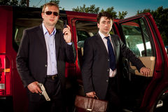 Bodyguard and its boss. Leave the car stock photos