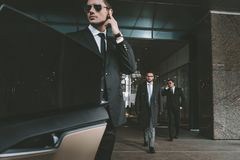 Bodyguard opening car door. For businessman royalty free stock photos