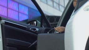 Bodyguard opening car door to female businesswoman, good service, business. Stock footage stock footage