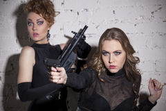 Bodyguard protecting. Two female spies in action royalty free stock photos
