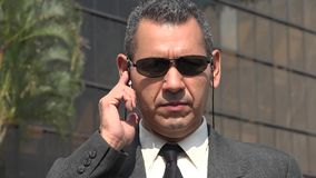 Bodyguard Or Security Officer. Older and hispanic business man stock image