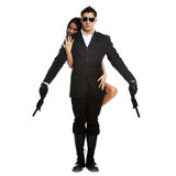 Bodyguard. Serious couple with arms, isolated on white royalty free stock photos
