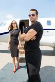 Bodyguard Standing Against Elegant Woman And royalty free stock photo