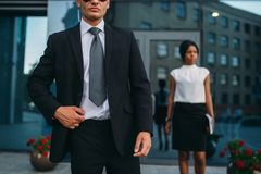 Bodyguard in suit and sunglasses, female VIP royalty free stock photo