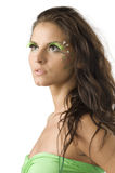 Bodypaint. Pretty girl with artificial green eyelashes and leaf painted on her face Stock Images