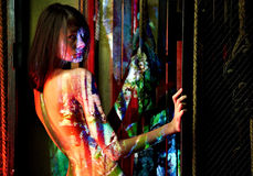 BodyPaint female. Bizzare portrait in industrilal background Stock Photos