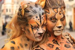 Bodypainted models in the street royalty free stock image