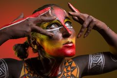Woman painted with ethnic patterns royalty free stock photo