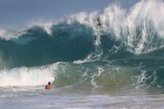 Bodysurfer over the falls at Sandy Beach Hawaii. Huge summer south swell breaks in waist deep crystal clear water at Sandy Beach, Hawaii.  Body surfer's risk it Stock Photo