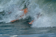 Bodysurfers Catching a Wave Royalty Free Stock Photo