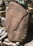Boeddhistische mantra op rode steen Royalty-vrije Stock Afbeeldingen