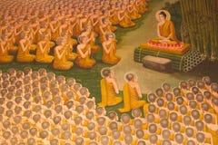 Boedha en de monniken stock foto