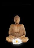 Boedha en de Witte Bloem van Lotus Royalty-vrije Stock Afbeeldingen