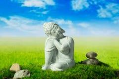 Boedha, stenen op de weide Royalty-vrije Stock Afbeeldingen