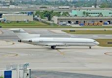 Boeing 727 cargo jet. Vintage Boeing 727-200 cargo jet on runway stock photo
