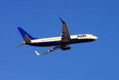 Boeing 737-800 airplane. Boeing 737-800 aeroplane taking off with undercarriage up Stock Image