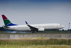Boeing 737-844 Landing. The Boeing 737-844 fixed wing aircraft, used as both commercial passenger airliner Royalty Free Stock Photography