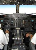 Boeing 737 cockpit. And pilots during flight stock photo
