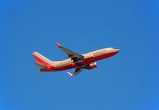 Boeing 737 passenger jet. Boeing 737-700 jet liner in flight royalty free stock images